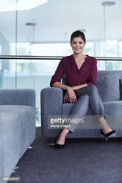 Confident businesswoman sitting on sofa