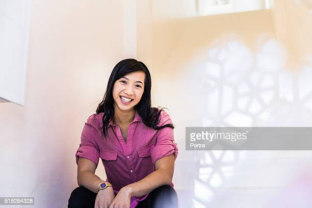 Confident businesswoman smiling while sitting in office