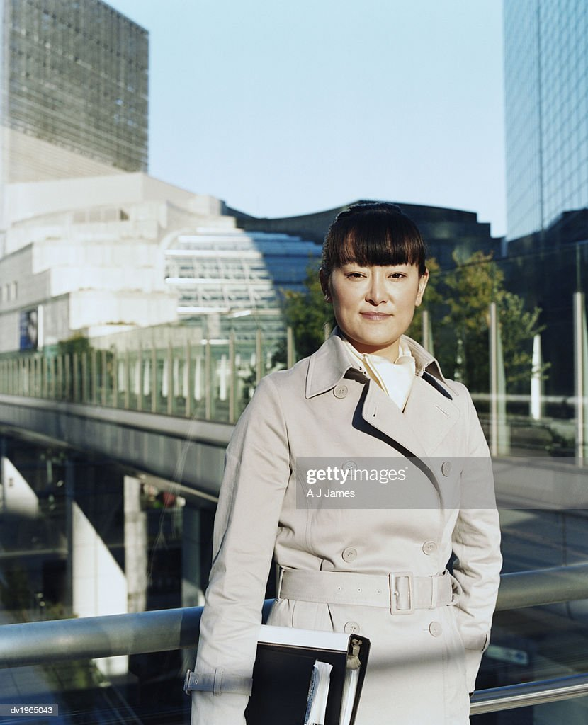 Confident Businesswoman Standing on a Footbridge : Stock Photo