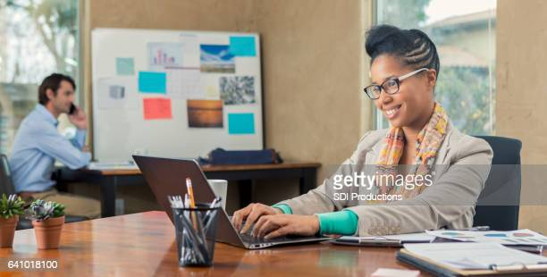 Confident businesswoman uses laptop computer in the office