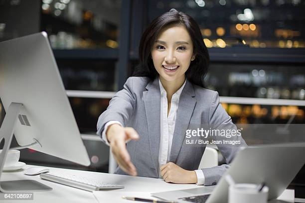 confident businesswoman working in office - social grace stock pictures, royalty-free photos & images