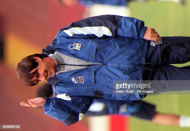 A confident Cesare Maldini Italy's football coach talks to his players at Wembley Stadium this afternoon before tomorrow's World cup Qualifying match...