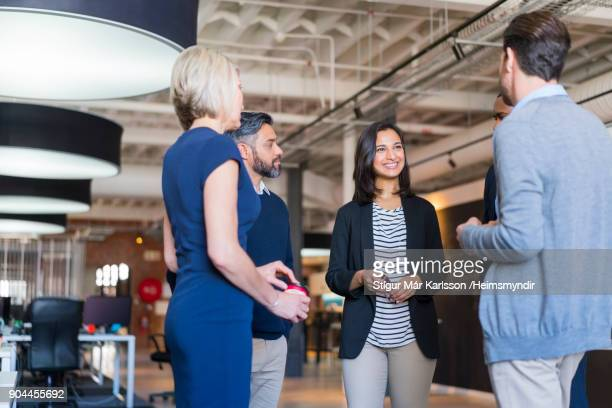 confident colleagues discussing in office meeting - event stock pictures, royalty-free photos & images