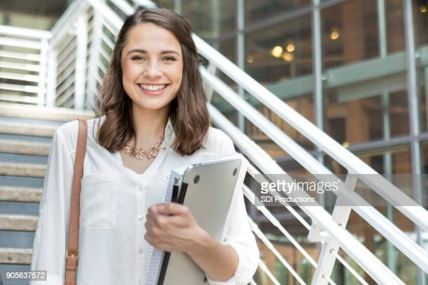 confident college student on her way to class - college student stock pictures, royalty-free photos & images