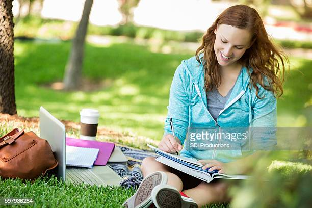 Confident college student studies on campus