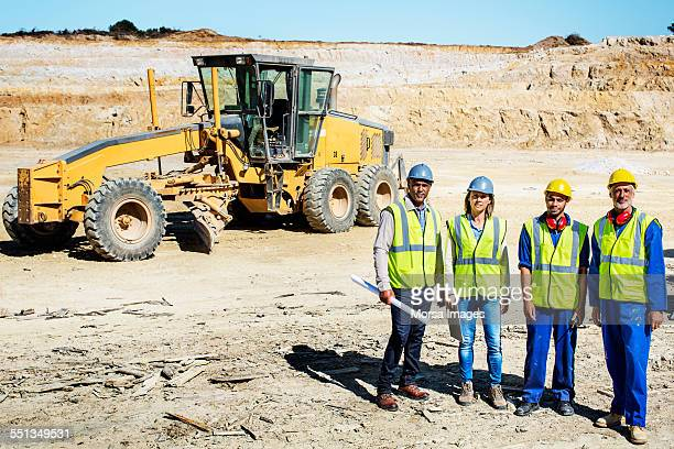 Confident construction site standing at quarry