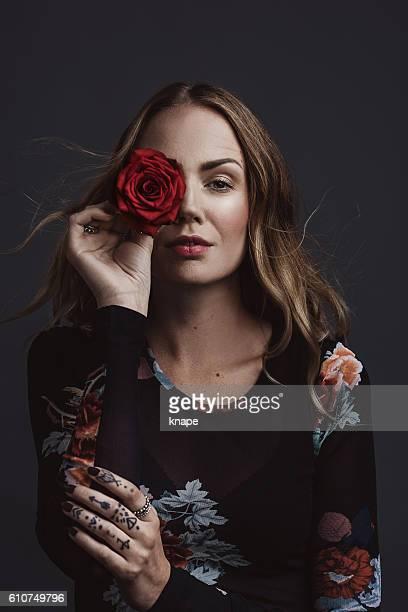 Confident cool real woman studio portrait