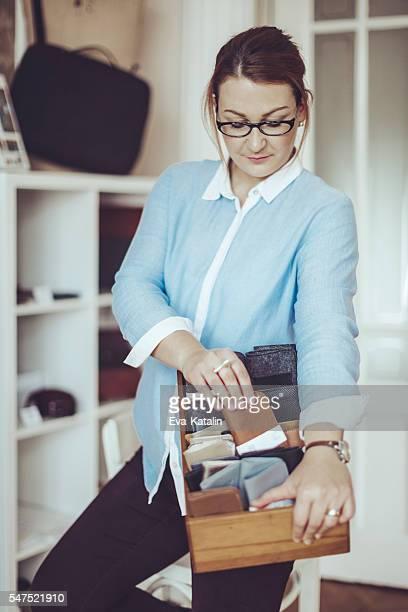 Confident craftswoman working in her workshop