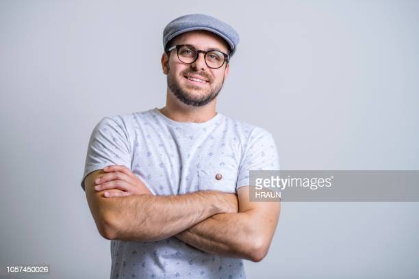 confident creative businessman against gray background - creative director stock pictures, royalty-free photos & images
