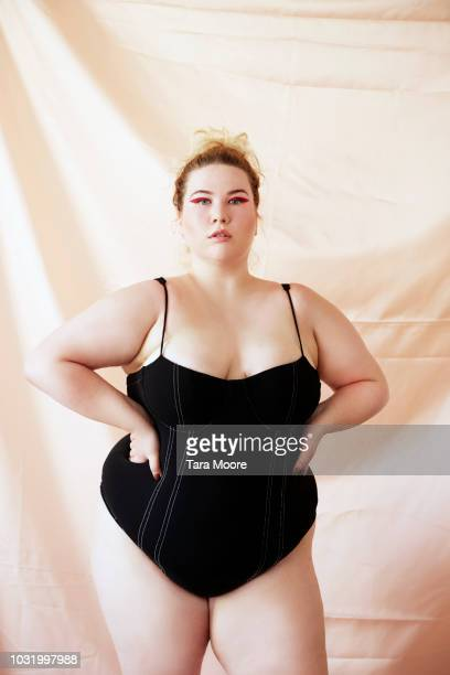 confident curvy woman in body suit