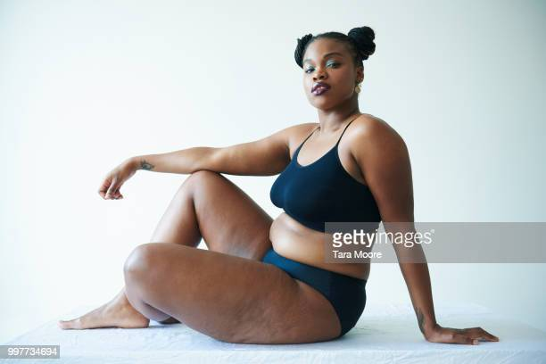 confident curvy woman sitting and looking to camera