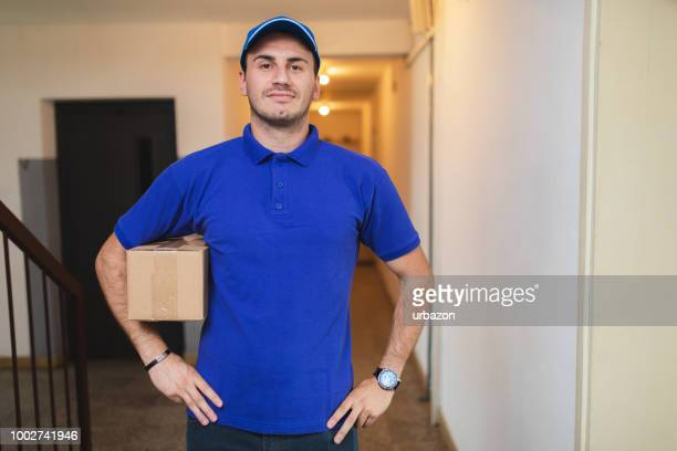 confident delivery - polo shirt stock pictures, royalty-free photos & images