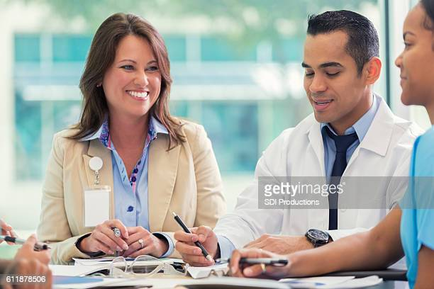 Confident doctor and hospital executive discuss strategy