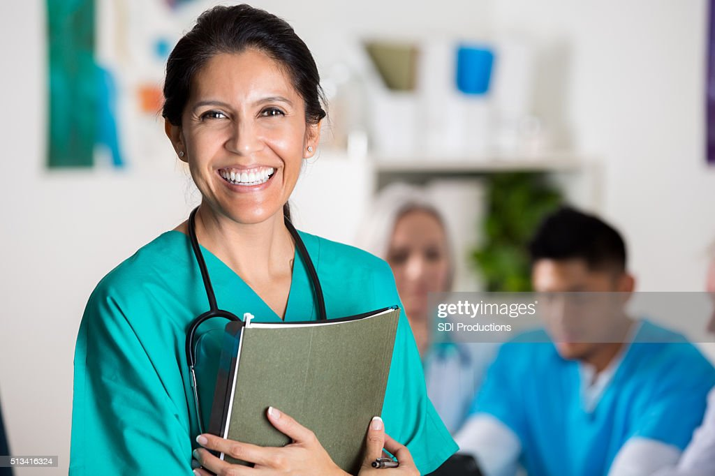 Confident doctor in medical staff meeting : Stock Photo