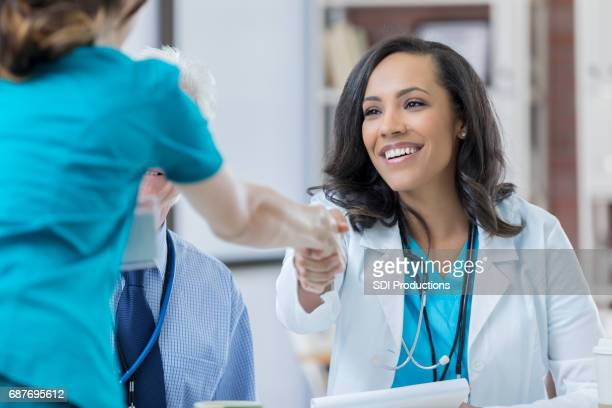 Confident doctor interviews nurse