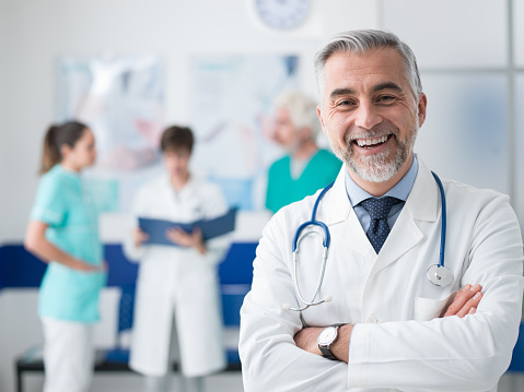Confident doctor posing at the hospital 938438758