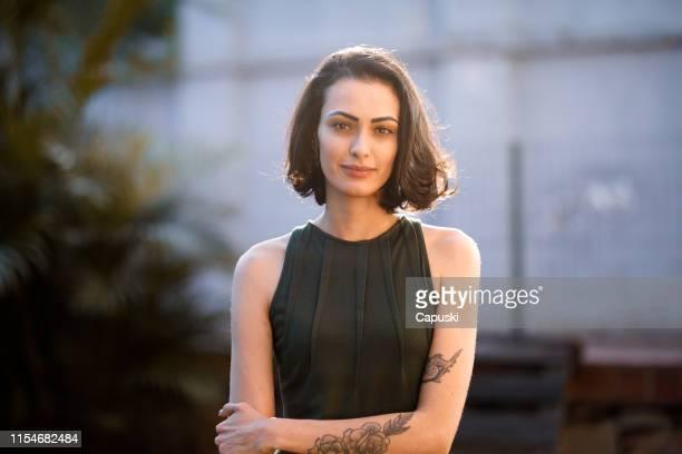 confident elegant young millennial businesswoman - 30 34 anos imagens e fotografias de stock
