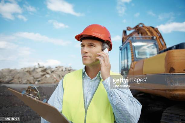 Confident engineer at work on construction site
