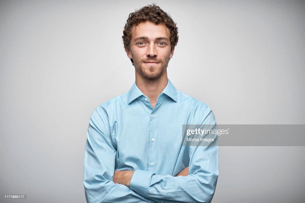 Confident entrepreneur against white background : Stockfoto