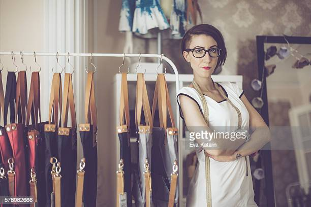 Confident fashion designer is working in her showroom.