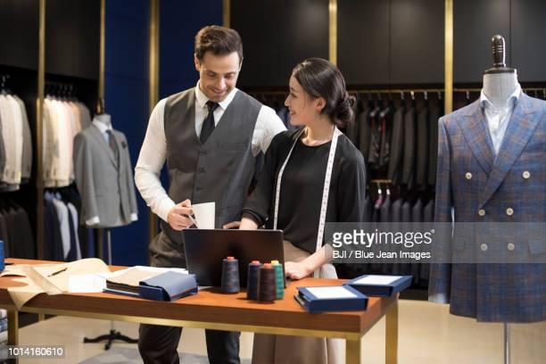 confident fashion designers working - herrenkleidung stock-fotos und bilder