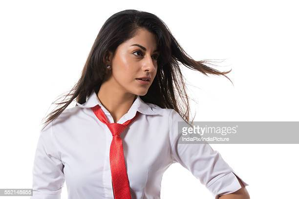 Confident fashionable businesswoman looking away over white background