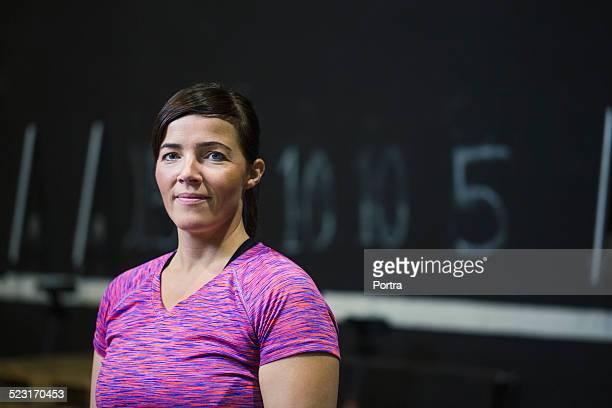 Confident female athlete at health club