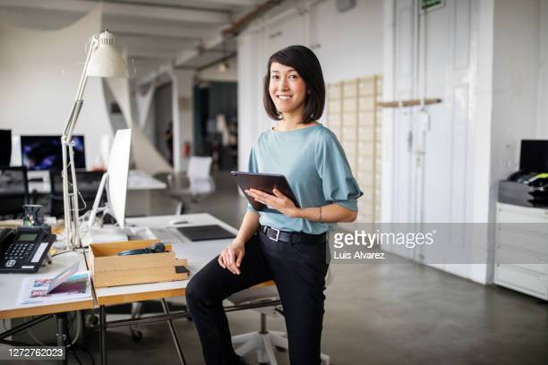 confident female business professional with digital tablet - standing stock pictures, royalty-free photos & images