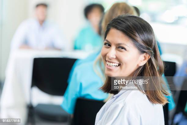 Confident female doctor attends medical conference