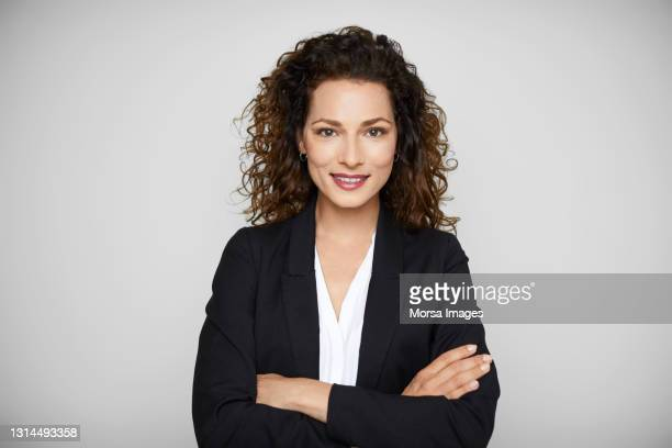 confident female entrepreneur against white background - business casual stock pictures, royalty-free photos & images