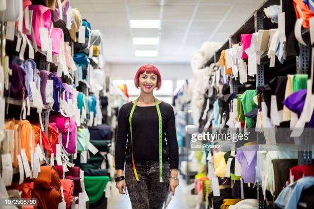 confident female fashion designer at shop - fashion designer stock photos and pictures