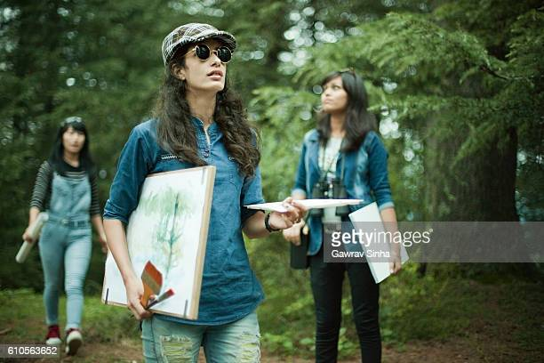 confident, female fine art college students in outdoor location. - indian college girls stockfoto's en -beelden
