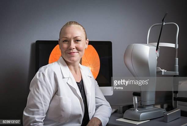 Confident female optometrist in clinic