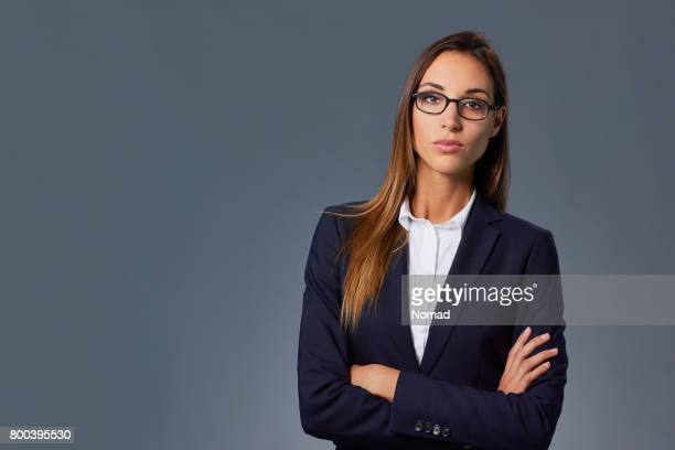 Confident female professional with arms crossed