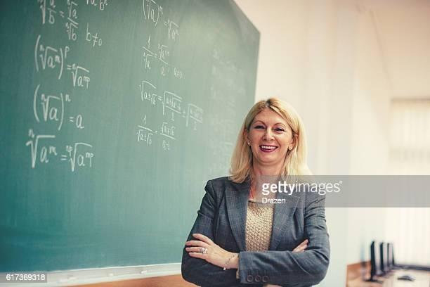 Confident female scientist in classroom