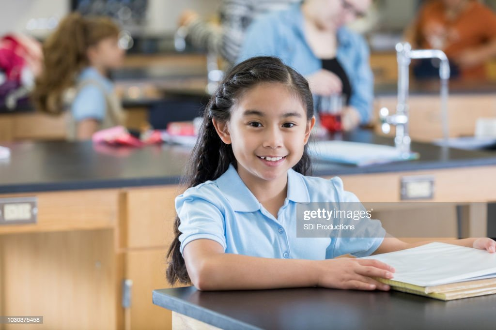 Confident female student in  the science lab : Stock Photo