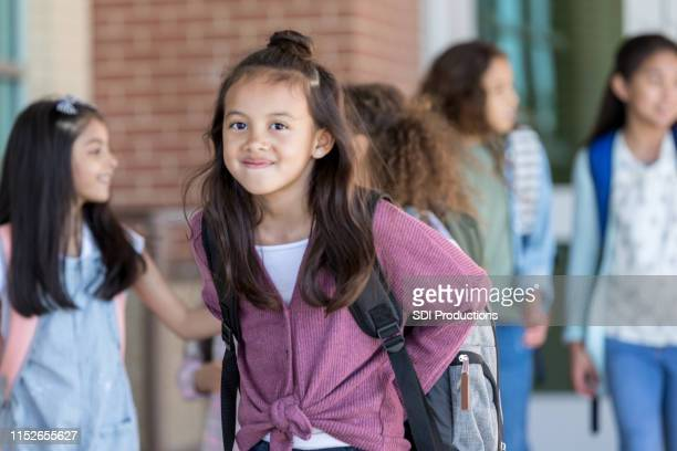 confident female student smiles at the camera - philippine independence day stock pictures, royalty-free photos & images