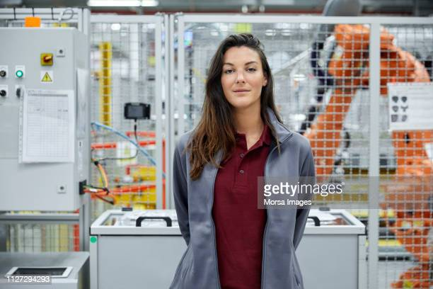 Confident female supervisor in automobile industry