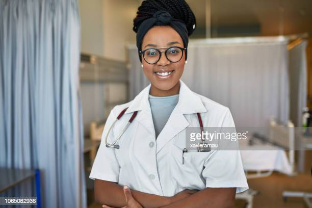 confident female trainee standing in hospital - medical student stock pictures, royalty-free photos & images