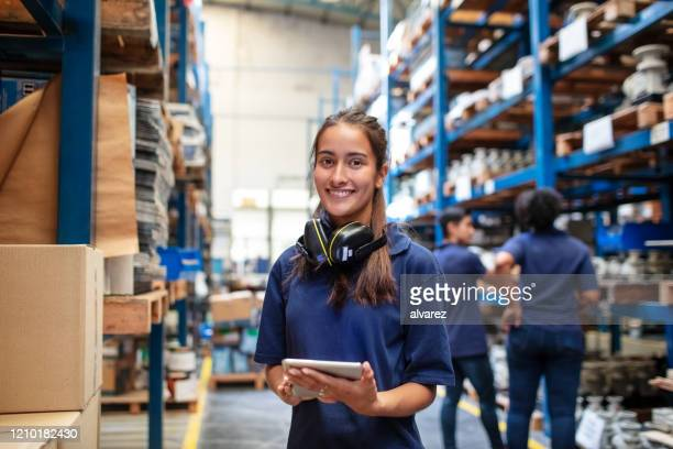 confident female warehouse worker - employee stock pictures, royalty-free photos & images