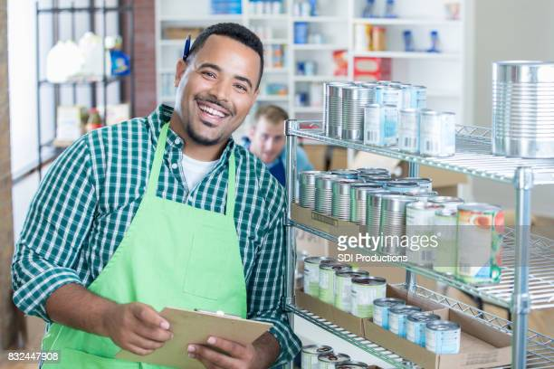 Confident food bank manager works in store room