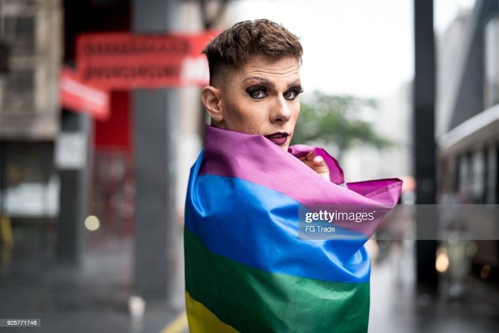Confident Gay Boy Holding Rainbow Flag : Stock Photo