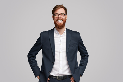 Confident ginger businessman smiling for camera 1153206642