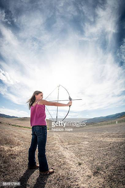 Confident girl aiming her bow.