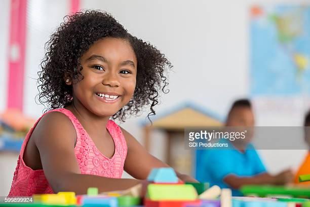 Confident girl in her kindergarten class
