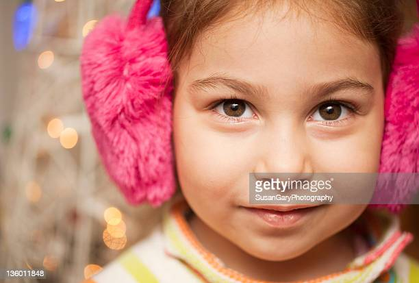 Confident girl in Pink Earmuffs
