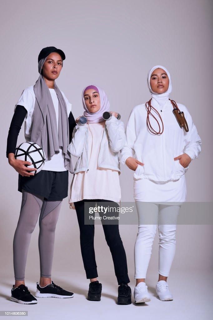 Confident group of female Muslim athletes : Stock Photo