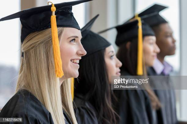 confident group of high school grads - high school graduation stock pictures, royalty-free photos & images
