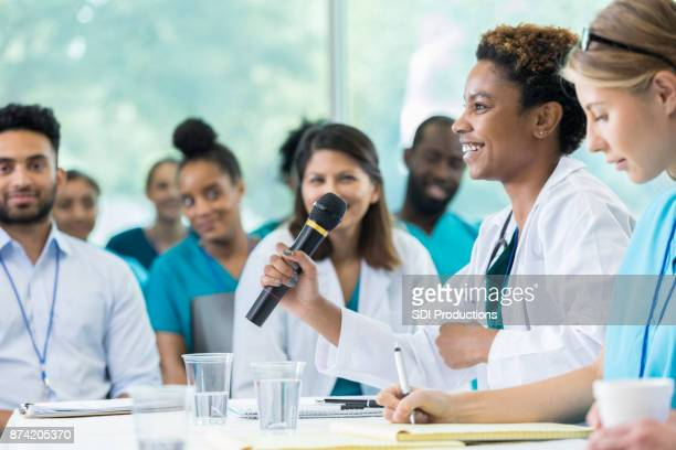 Confident group of medical professionals participate in panel discussion