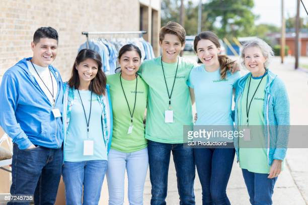 confident group of volunteers - humanitarian aid stock pictures, royalty-free photos & images